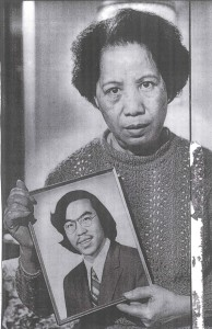 Lily Chin holds a photo of her son, Vincent Chin.