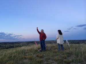 Basil Brave Heart, a Lakota elder, salutes the heavens and the forces of nature near a sacred medicine wheel in the Pine Ridge Indian Reservation. (Photo by Bobby Caina Calvan)