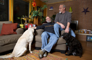 (Photo by Kaylee Everly/Lincoln Journal Star) Greg Tubach (left) and Bil Roby share a candid moment Friday in their Lincoln home while waiting to get their photo taken with two of their dogs, Grace (left) and Abby. The two men have been together for 28 years and are the only unmarried couple who are part of a lawsuit filed by the American Civil Liberties Union of Nebraska on behalf of seven couples seeking the right to marry.