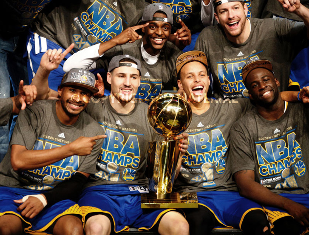 The Golden State Warriors, including Golden State Warriors' Klay Thompson (11) and Golden State Warriors' Stephen Curry (30) celebrates with the NBA championship trophy after the Golden State Warriors 105-97 win over the Cleveland Cavaliers in Game 6 of the NBA Finals to win the NBA Championship at Quicken Loans Arena in Cleveland, Ohio, on Tuesday, June 16, 2015.  (Nhat V. Meyer/Bay Area News Group)