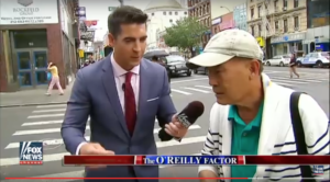 Henry Leung, right, is interviewed by FOX News correspondent Jesse Watters, whose recent piece on Chinatown is being widely criticized by Asian American groups and journalists. Leung says Watters never introduced himself as a FOX News correspondent.