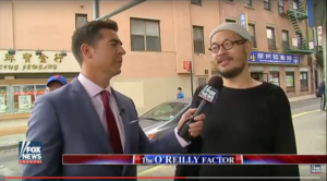 Qanta Shimizu, right, speaks with FOX News correspondent Jesse Watters in New York City's Chinatown. Shimizu says he was unaware how he would be portrayed in a piece that Asian American groups and journalists have criticized. (Photo still taken from a video posted by FOX News on YouTube.)